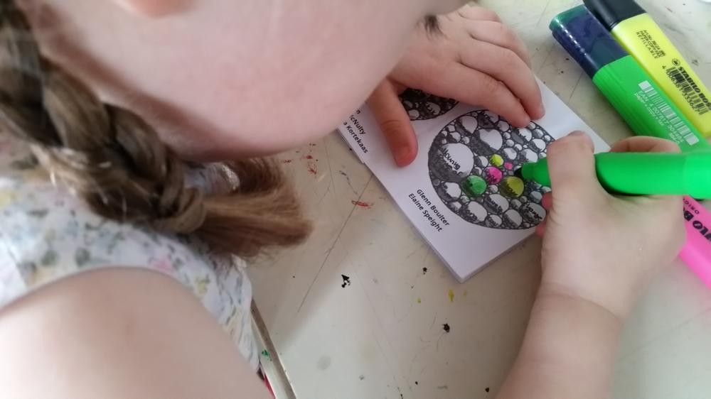 Child colouring in.